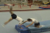 Handstand half twist to knees from box toptwist cart wheelGymnastics Drills Coaching
