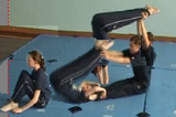 Lifting from Ankle Grasp to Box Shaped Balance into forwards rollKey 5 Partner LiftingGymnastics Drills Coaching