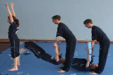 Bridge lift and pull, to aid a neckspring to feet.Key 5 Partner LiftingGymnastics Drills Coaching